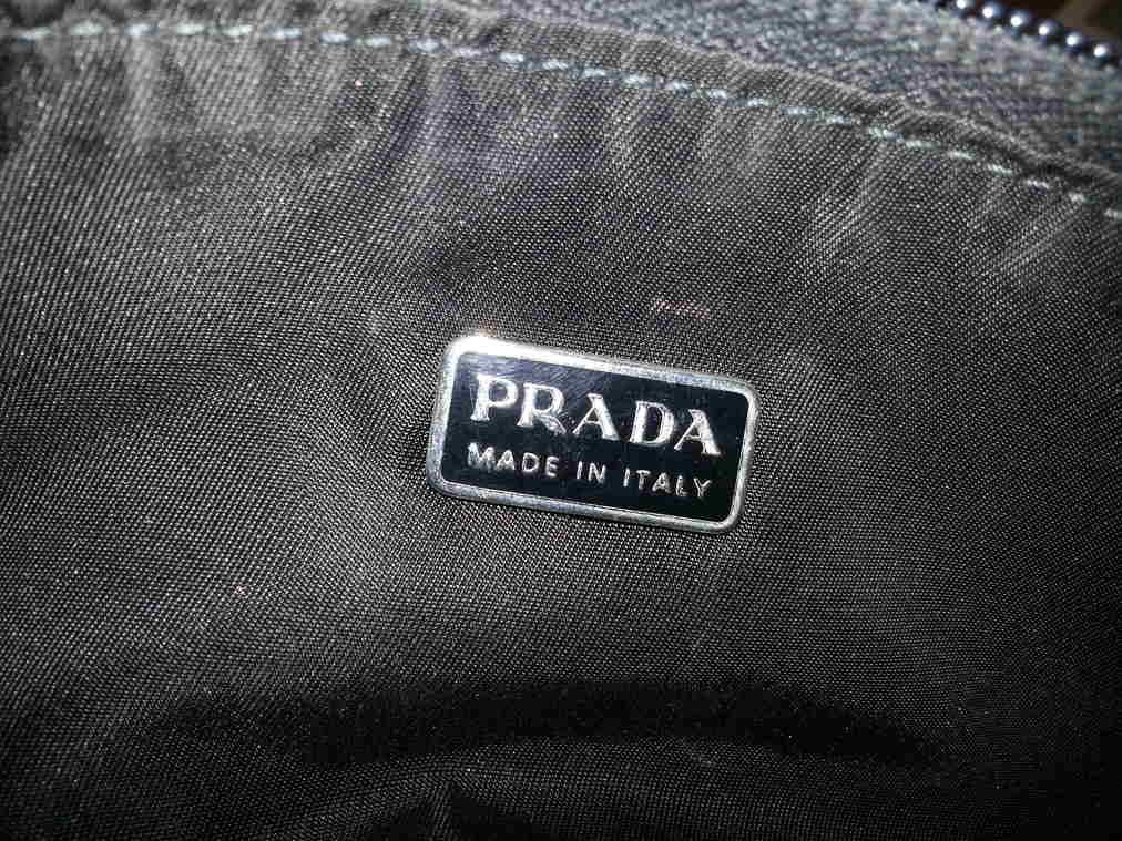 Interior Prada Logo on a Black Prada Evening Bag