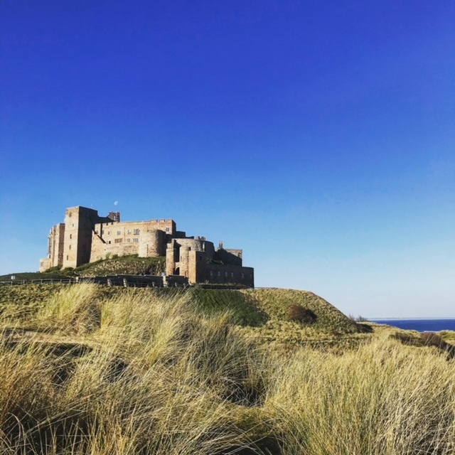 a castle on a hill overlooking the North Sea
