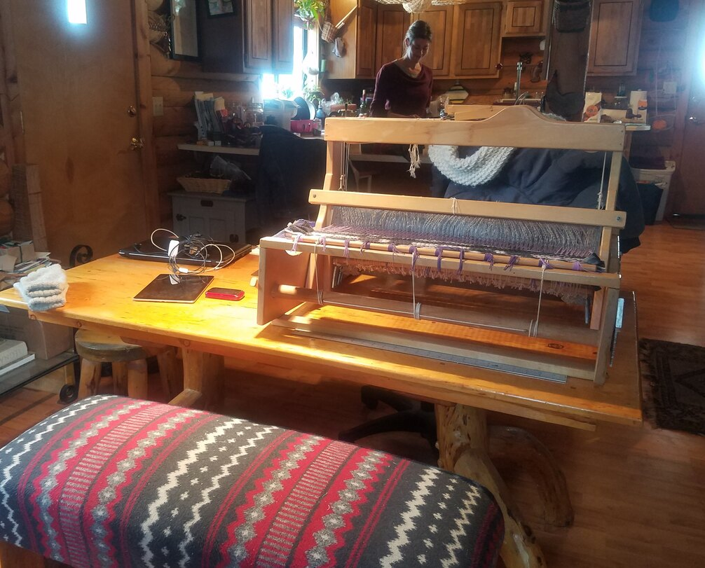 table top loom on a table in a dining room