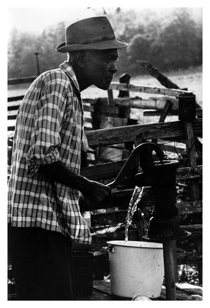 Robert Jackson pumps water, near Crawfordville FL