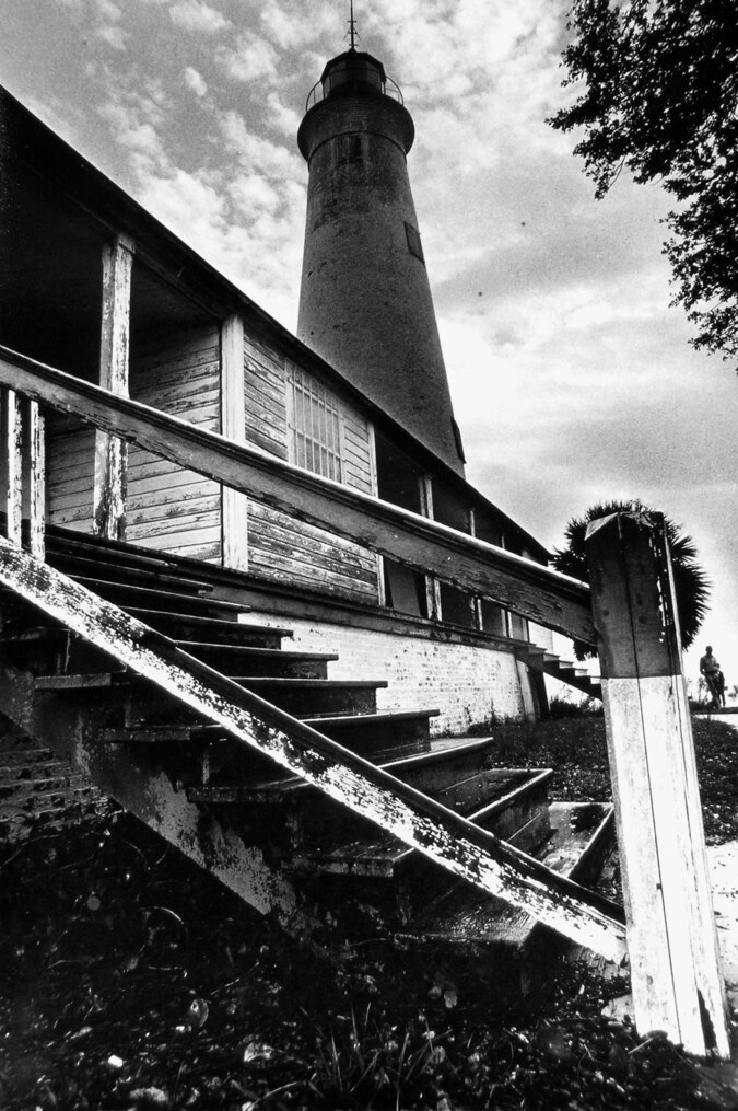 a black and white wide angle shot of the lighthouse at St Marks National Wildlife Refuge