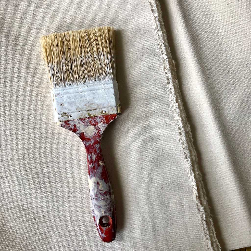 Raw canvas with paintbrush