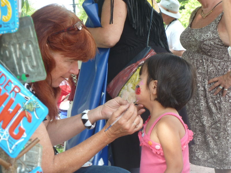 Face Painting a Little Girl