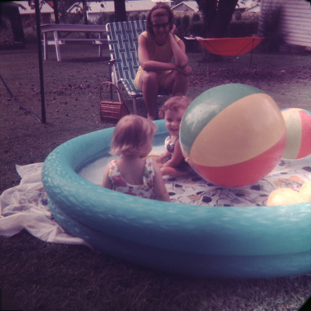toddlers playing in a wadng pool