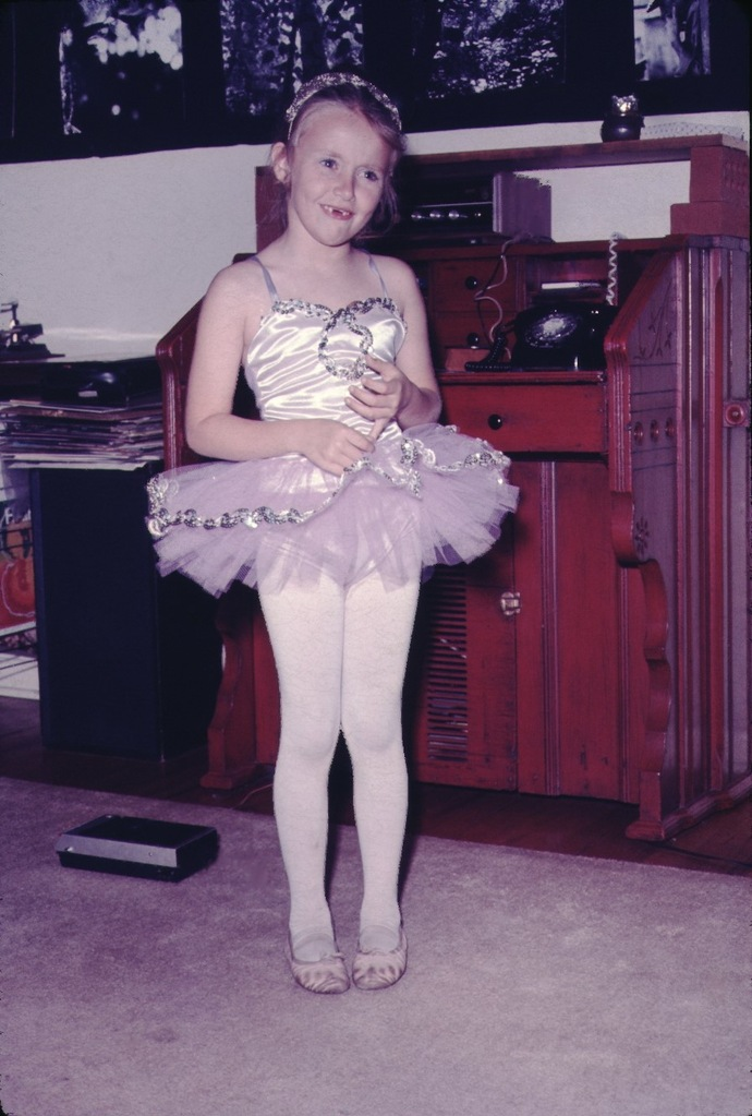 a young girl in a tutu; a ballet performance costume