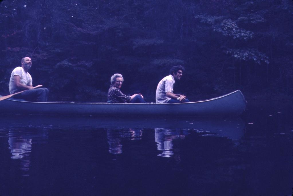 three people in a canoe