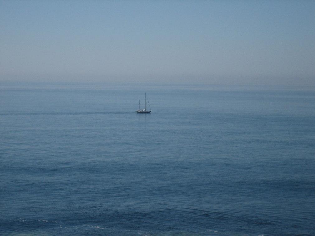 Boat on Irish Sea near Hooks Head Lighthouse