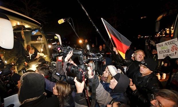 "Protestors ""greet"" a refugee bus"