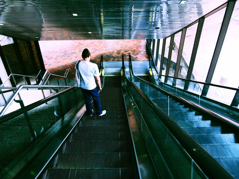 Woman on the escalator.