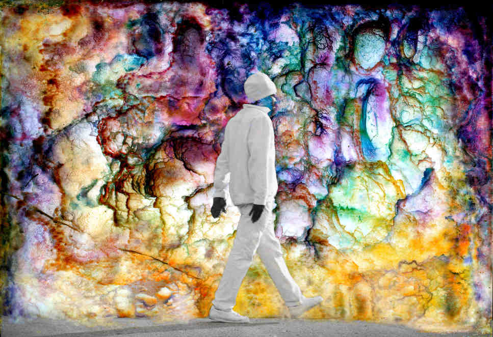Monochromatic man steps into a world of color.