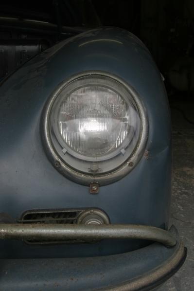 A 1957 Porsche 356 Speedster headlight