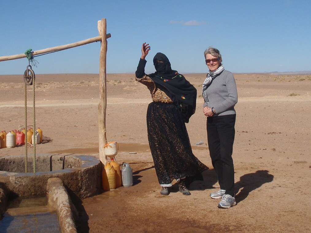 The Blue Marbles Project: Lady Fetching Water from Well, Ann Henry, Sahara Desert (2011)