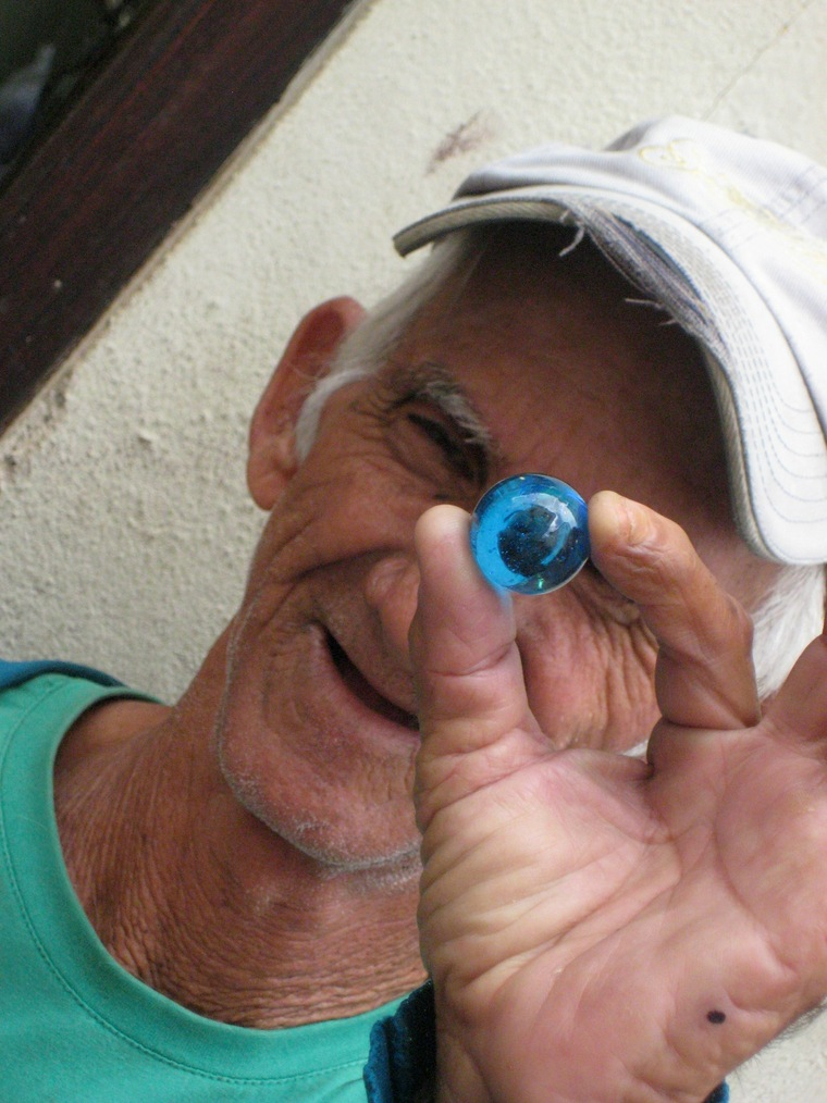 The Blue Marbles Project: Man with Blue Marble, Cuba (2010)