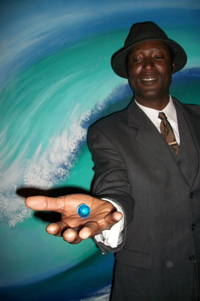 Composer/bassist Marcus Shelby receives one blue marble on the set of the African American Shakepeare Company's 2011 production of Twelfth Night.