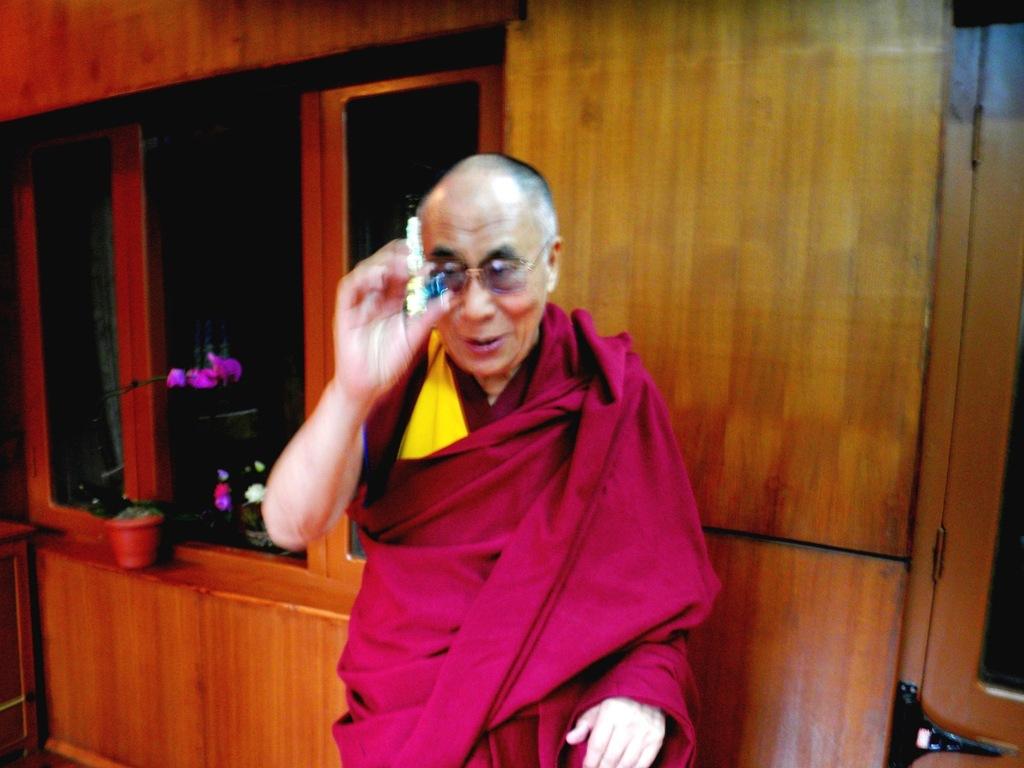 The Dalai Lama receives one blue marble.