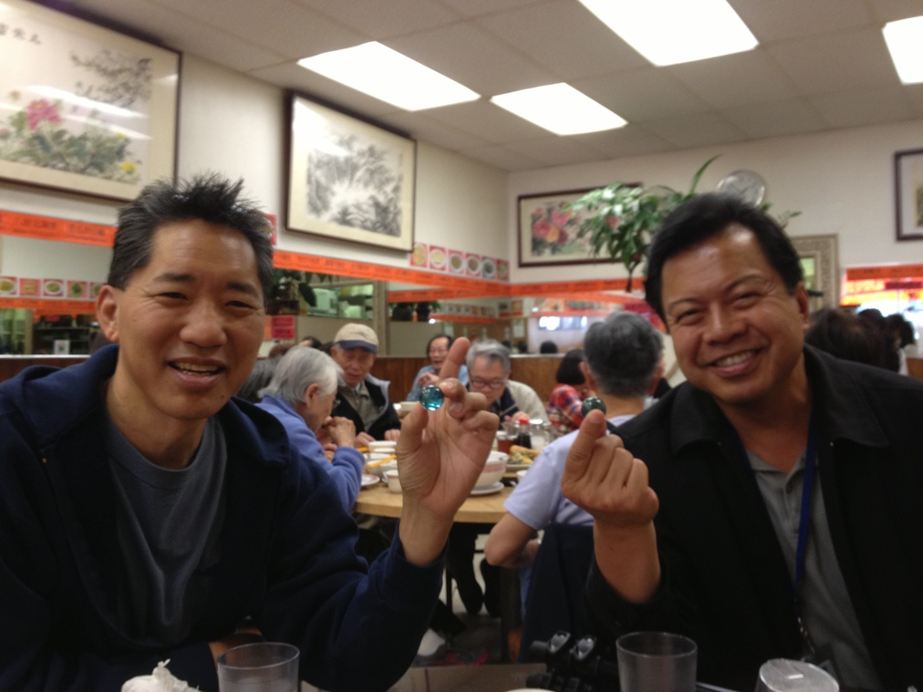 Filmmakers Ryan Yip and Rick Quan receive their blue marbles at Capital Restaurant in San Francisco's Chinatown.