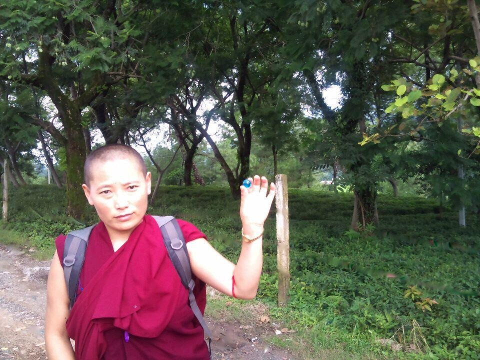 A Tibetan nun with her Blue Marble