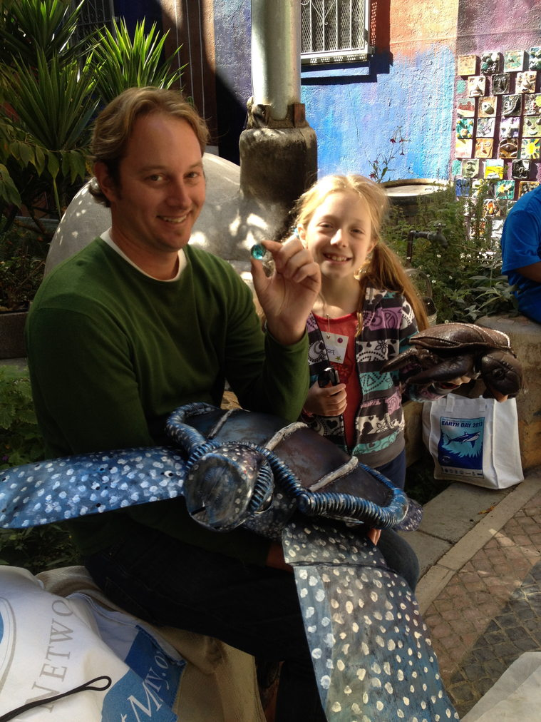 Sea turtle lover Elisa has a one blue marble thank you for sea turtle protector Dr. Chris Pincetech.