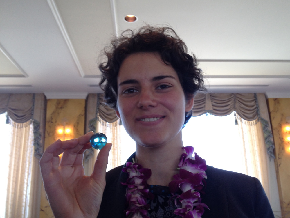 Anna Waldman-Brown, director and co-founder of the Practical Education Network, receives one blue marble.