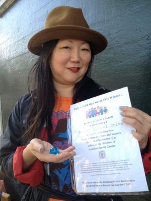 Comedian/actress Margaret Cho receives one blue marble on the corner of Haight and Ashbury.
