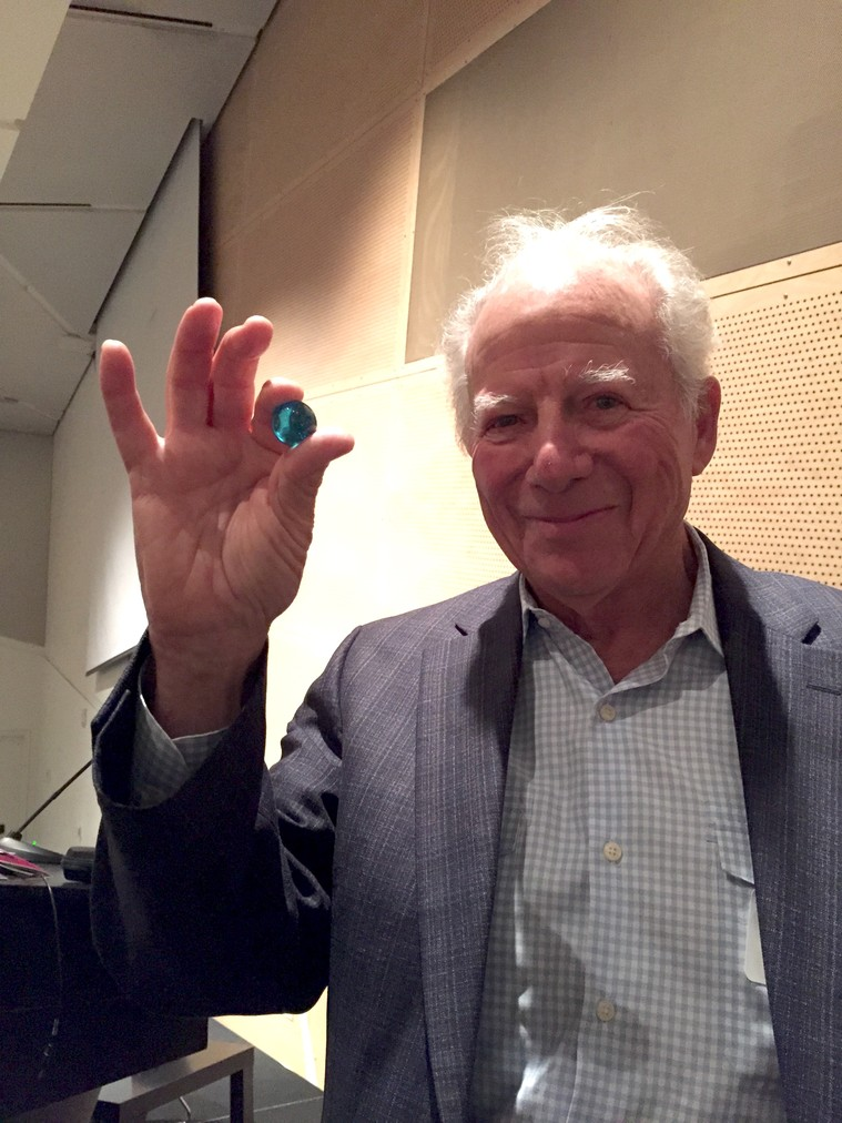 Dr. Stuart Brown, the founder of the National Institute for Play, receives one blue marble.