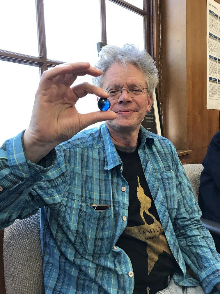 David Harrington, violinist and founder of the Kronos Quartet, receives one blue marble.