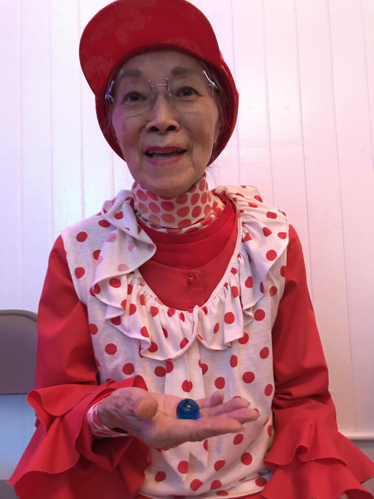 Chinatown researcher Dorothy G.C. Quock, aka Polkadot, receives one blue marble.