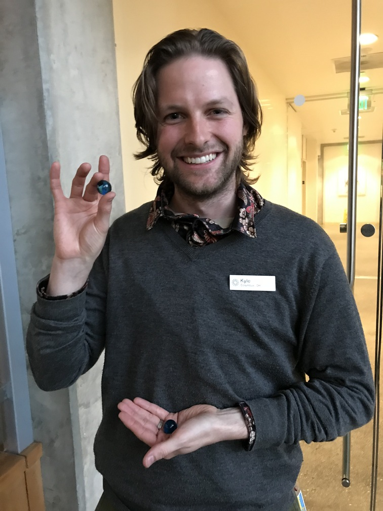 Kyle Foster, Public Programs Lead at the California Academy of Sciences receives one blue marble.
