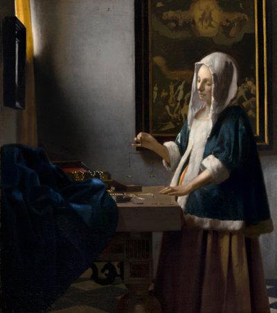 Woman Holding a Balance