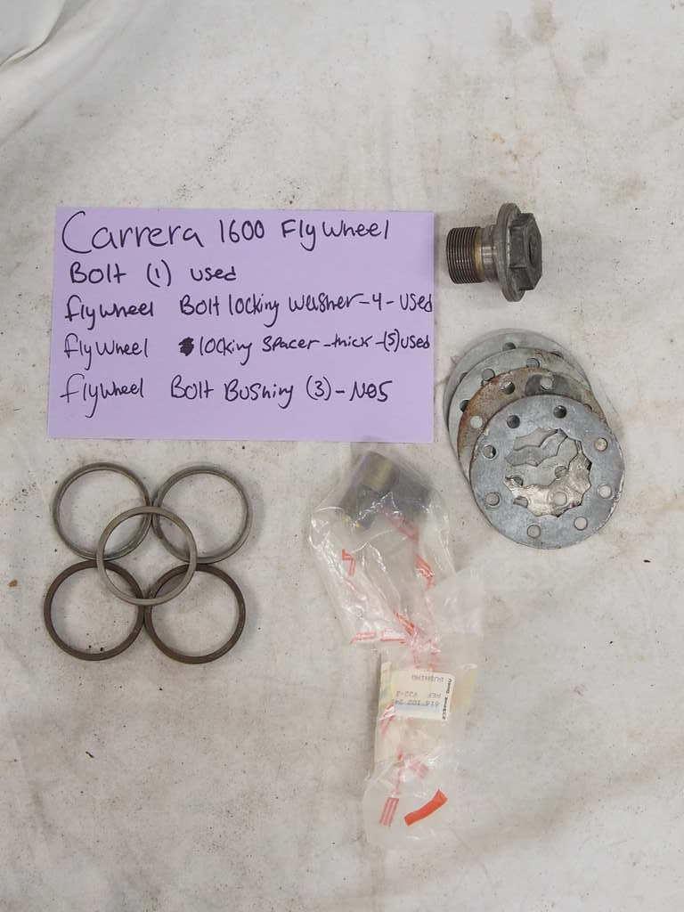 Carrera 1600 fly wheel bolt (1) - Used #692 102 025 00 Flywheel bolt locking washer - Used (4)  Flywheel locking spacer - Thick (5) - Used Flywheel bolt bushing(3) - NOS